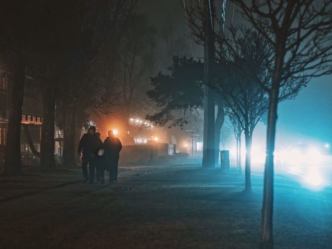 Illuminated Outdoors Night Fog People Streetphotography Colors Moody Cinematic Mystery Trees Light EyeEm Best Shots