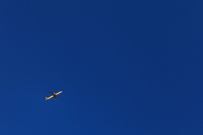Air Vehicle Airplane Blue Clear Sky Distant Emptiness Empty Flight Flying Journey Low Angle View Mid-air Miniscule Mode Of Transport No People Sky Transportation