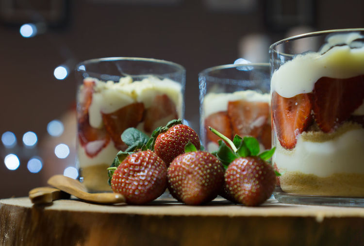 Close-up of fresh fruits in glass on table