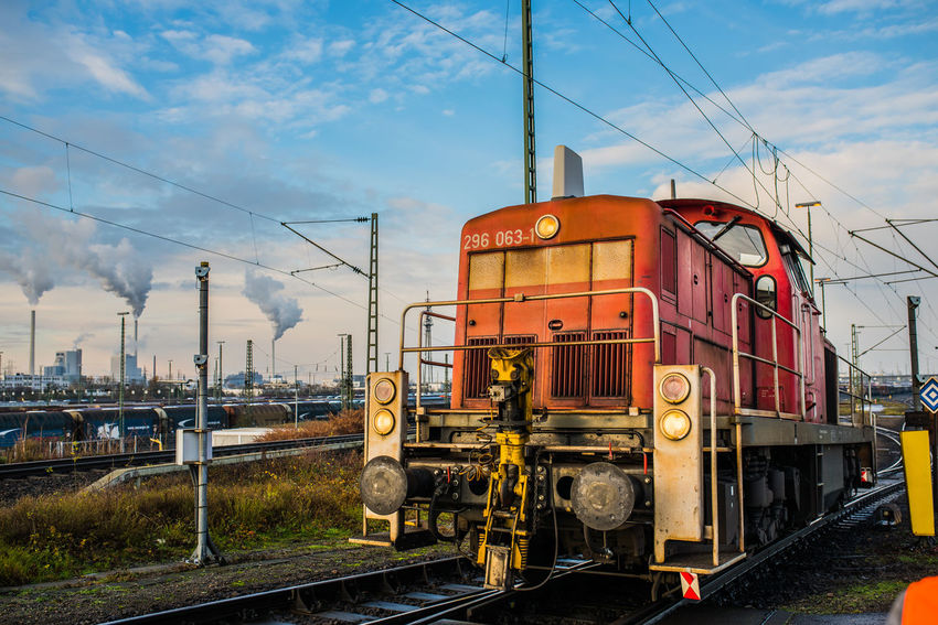 DB Cargo Architecture Built Structure Cable Cloud - Sky Day Freight Transportation Land Vehicle Locomotive Mode Of Transport No People Outdoors Public Transportation Rail Transportation Railroad Track Shunting Yard Sky Steam Train Technology Train - Vehicle Transportation