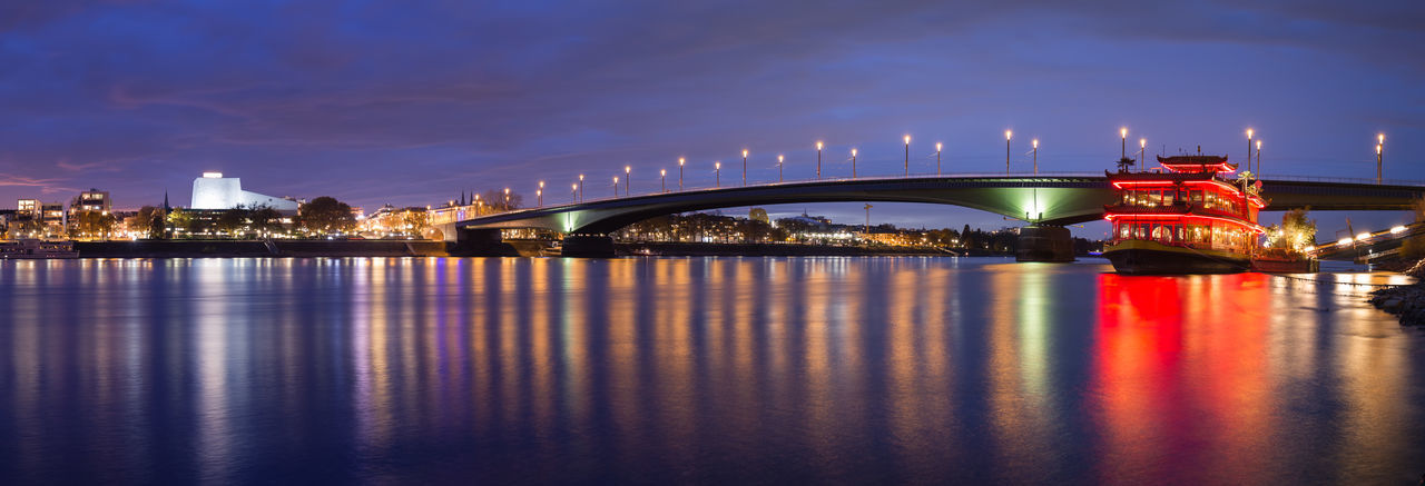 Panorama of the illuminated Kennedy Bridge and the river Rhine in blue hour after sunset in Bonn, Germany Architecture Bridge Reflection Illuminated Bridge - Man Made Structure Water River No People Travel Destinations Cityscape Bonn Germany Kennedy Kennedy Bridge Kennedybrücke Opéra Rhine Rhine River Cologne Built Structure Connection Night Long Exposure