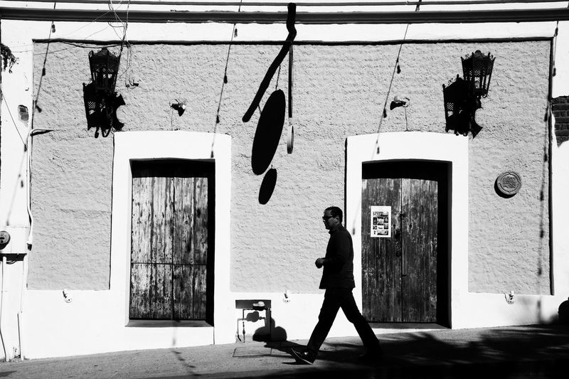 Streetphoto_bw Streetphotography Full Length One Person Real People Day Wall - Building Feature Silhouette Walking Graffiti Art And Craft The Art Of Street Photography