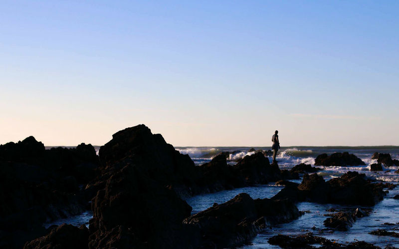 Silhouette Travel Landscape Sunset Sky Nature Outdoors Day New Horizons Precarious Ladyphotographerofthemonth Cornwall Beach Life Landscapes Finding New Frontiers Horizon Over Water Men Real People Beauty In Nature People Coastline Lifestyles Beach One Person Long Goodbye Lost In The Landscape