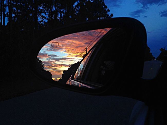 Car Transportation Mode Of Transport Land Vehicle Sunset Cloud - Sky Sky Side-view Mirror Cloud Reflection Close-up Window Dramatic Sky Journey Outdoors Cloudy
