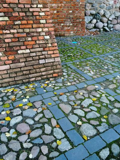 Old Town walls, Warsaw, Poland. Fortification Pattern No People Day Outdoors Tranquil Scene Leaves 🍁 Nobody Europe Town Urban Wall City Old Brick Scenics