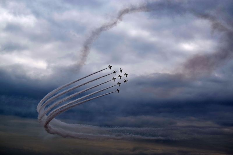 The RAF Ref Red Arrows display team performing on a stormy day Raf Redarrows Airdisplay