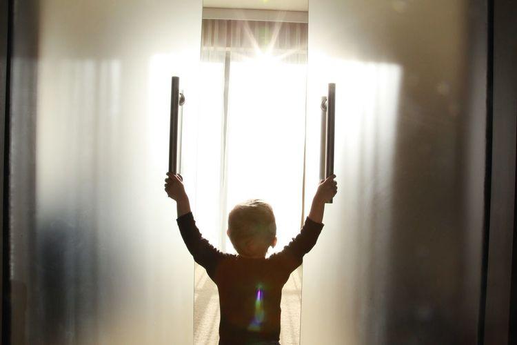 Back Lit Child Childhood Children Photography Day Hope Indoors  One Person Sun Sunbeam Sunlight The City Light