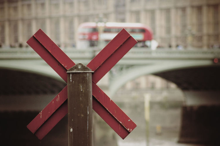 London Bridge London England Red Cross Sign Water Bridge Red Bus Daylight Learn And Shoot