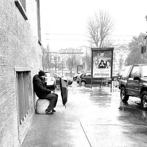 Real People Built Structure Day Outdoors Men One Person Raining Raining Day Streetphotography Street Photography Black & White City Life Blackandwhite Black And White Streetphoto_bw Umbrella
