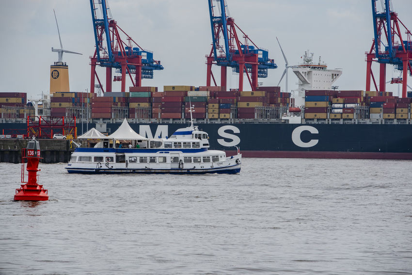 Hamburg, Germany - June 16, 2018: Container terminal Burchardkai in Hamburg on the Elbe Container Ship Container Terminal Burchardkai Elbvertiefung Goods Hamburg Hamburg Harbour Logistics Saint Pauli Transport Walter's Court Container Bridge Container Envelope Container Terminal Crane Export Freighter Harbor Basin Harbor Round Trip Import Landmark Shipping Company The Elbe Trade