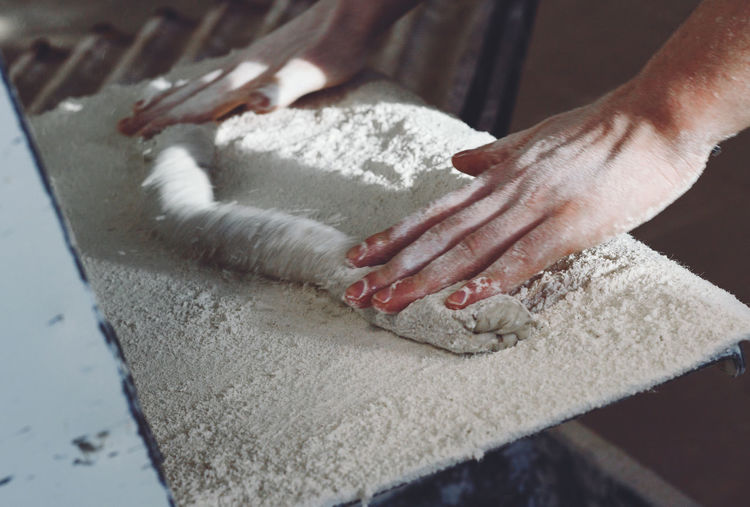 Close-Up Of Hands Making Dough