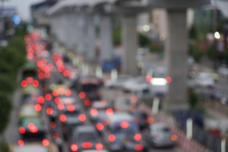Defocused image of traffic on city street