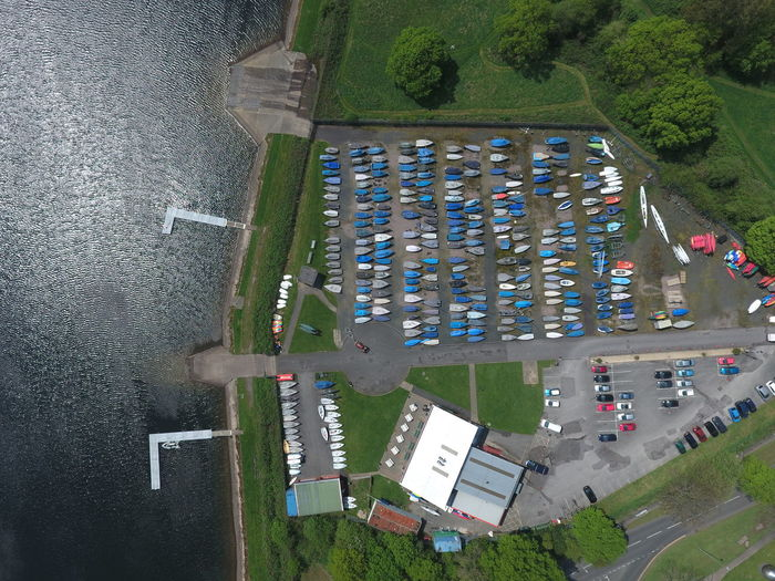 Directly above shot of kayaks moored at park by lakeshore