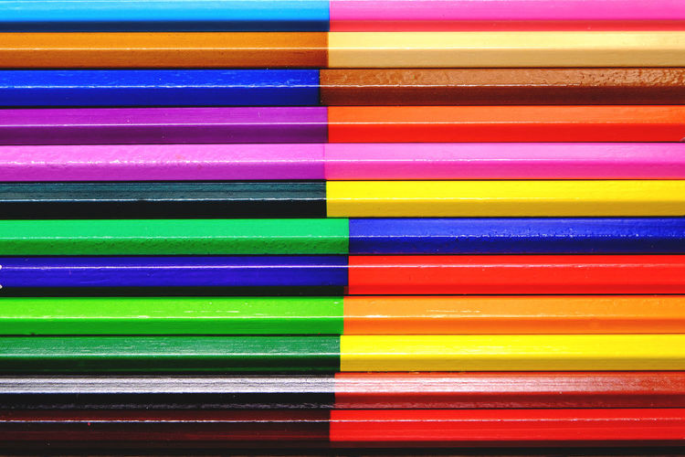 Full frame shot of colored pencils on table