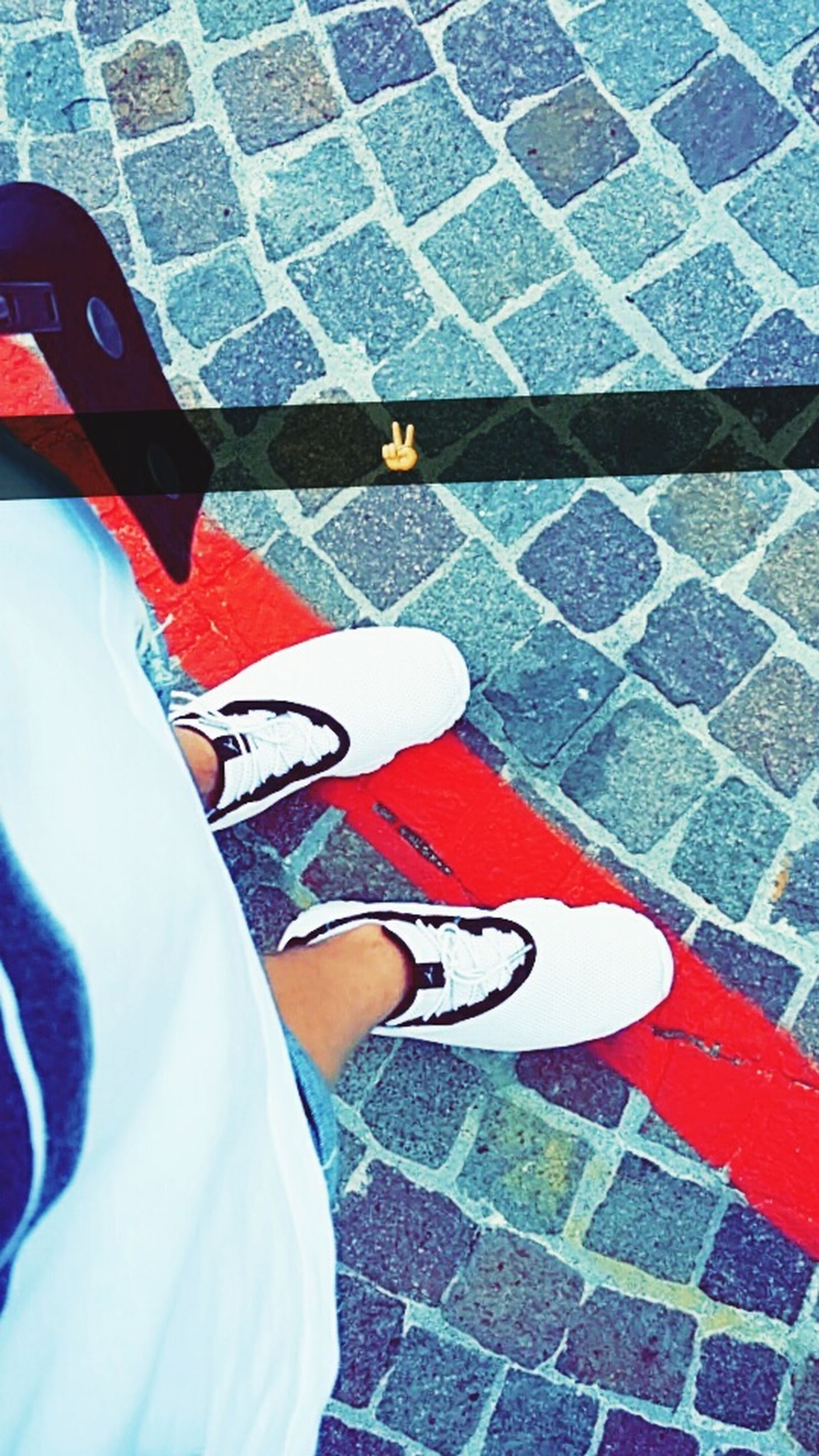 low section, person, shoe, lifestyles, high angle view, standing, street, leisure activity, footwear, personal perspective, red, men, casual clothing, human foot, cobblestone, jeans