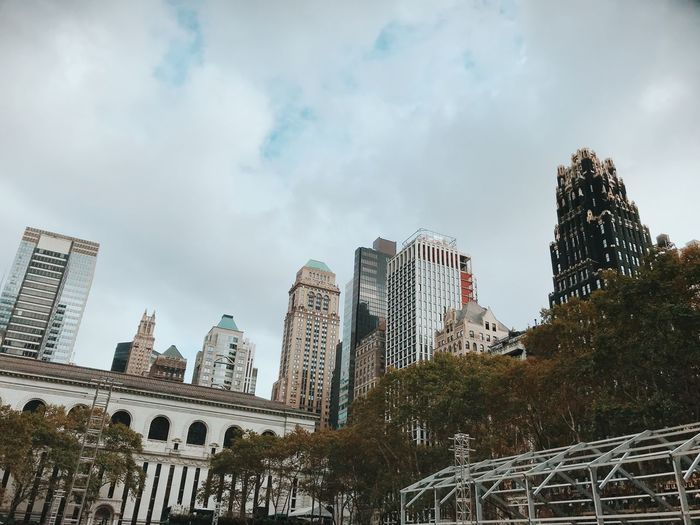 Fall in Bryant Park, NYC Architecture Skyscraper Built Structure Building Exterior Sky Low Angle View Cloud - Sky City Day No People Outdoors Modern Travel Destinations Growth Cityscape Bryant Park NYC Skyline NYC Photography New York City NYC New York Skyscrapers Buildings Urban Skyline Bryant Park Hotel