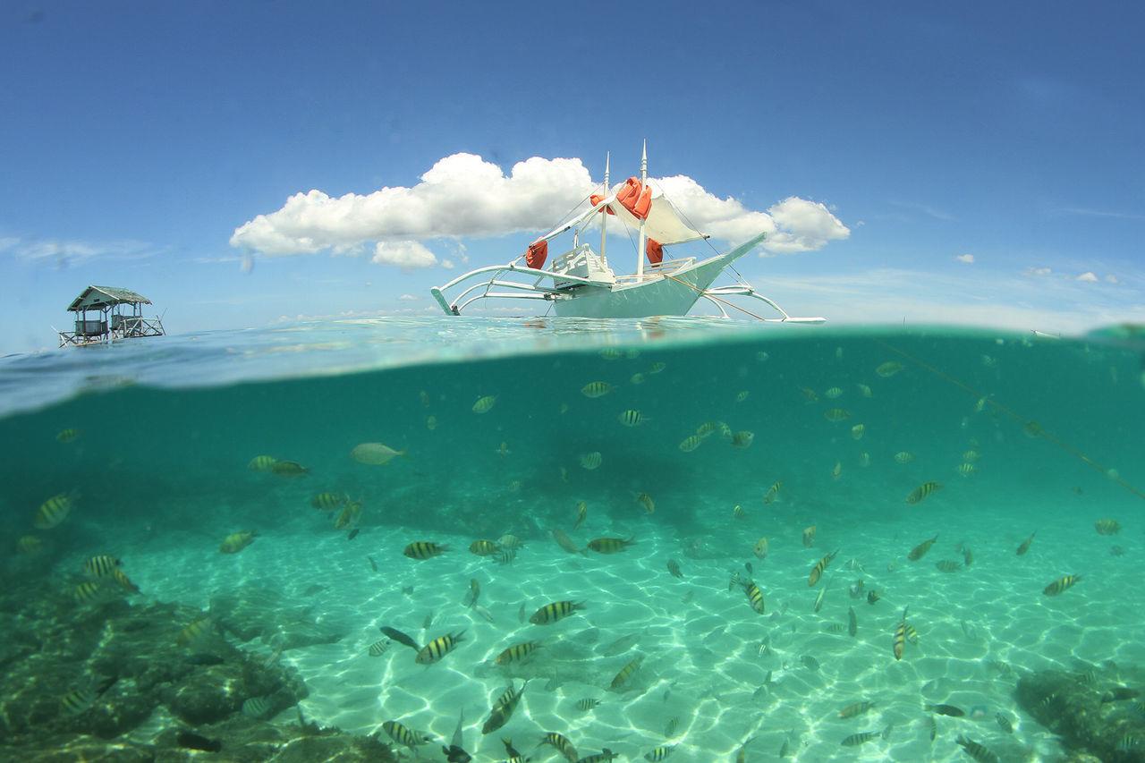 NAUTICAL VESSEL IN SEA AGAINST SKY