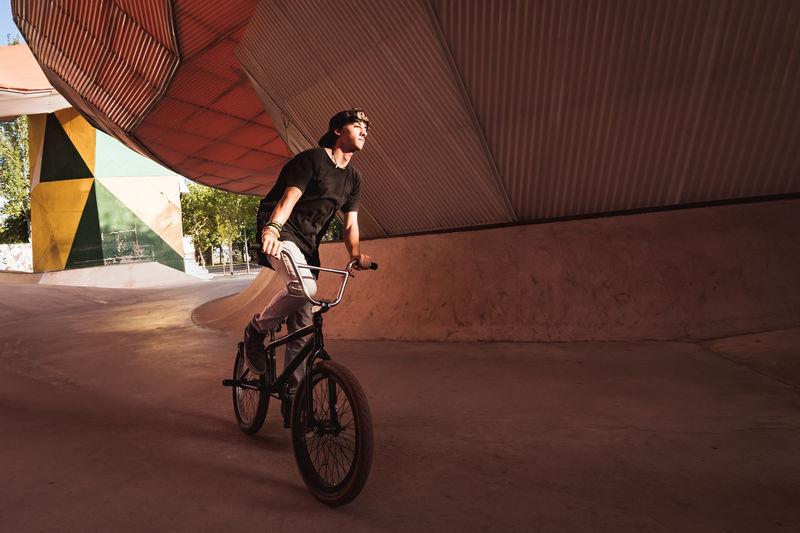 Young Man Riding Bicycle At Park