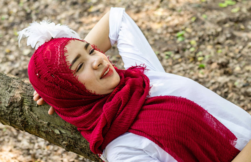 Portrait of smiling woman relaxing outdoors