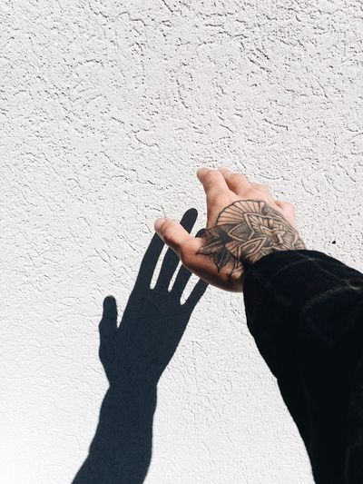Shadow One Person Human Body Part Human Hand Leisure Activity Sunlight Day Lifestyles Real People People Adult Women Outdoors Tattoo