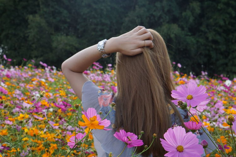Girl in a cosmos flower field Adult Arms Raised Asian Girl Beauty In Nature Day Flower Flower Head Flowering Plant Fragility Freshness Growth Hair Hairstyle Human Arm Human Hair Leisure Activity Lifestyles Long Hair Nature One Person Outdoors Plant Real People Vulnerability  Women The Traveler - 2018 EyeEm Awards