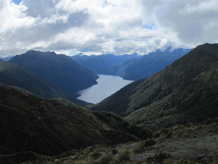 Mountain Sky Environment Landscape Cloud - Sky Mountain Range Beauty In Nature Scenics - Nature Nature Tranquility No People Tranquil Scene Land Mountain Peak Day Water Outdoors Valley Non-urban Scene Wilderness High Range Height New Zealand Kepler Track