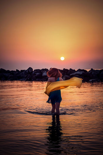 Adult Adults Only Beauty In Nature Day Full Length Lifestyles Nature One Person Orange Color Outdoors People Portrait Real People Scenics Sea Sky Standing Sun Sunset Tranquil Scene Tranquility Water Women Young Adult