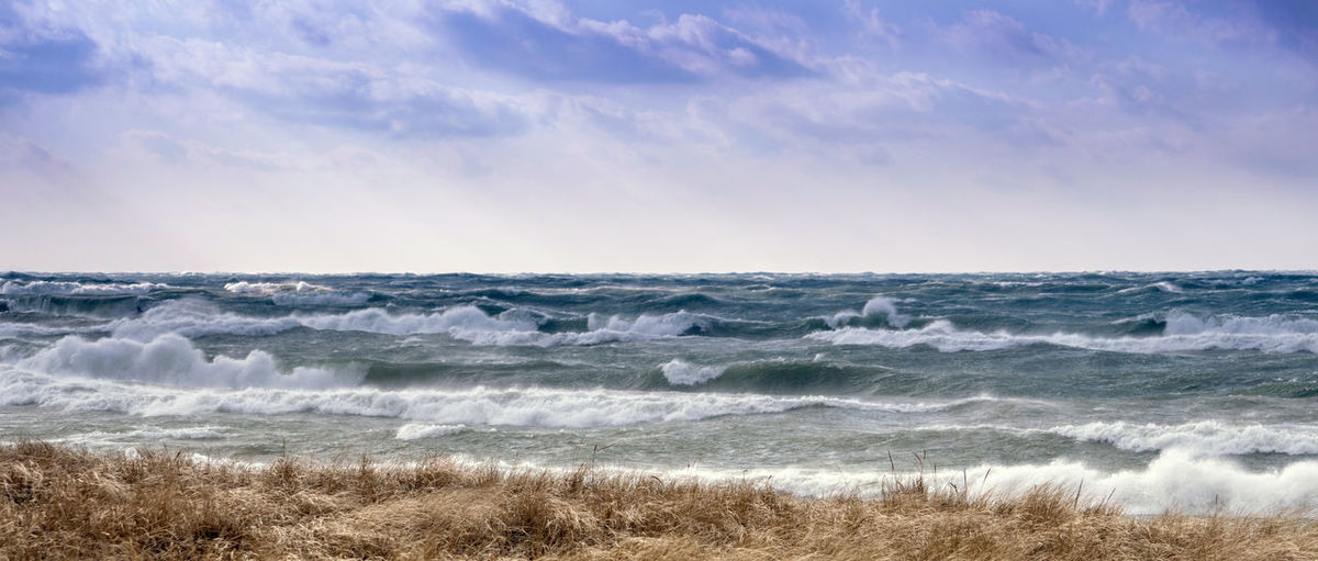 Panorama of a windy, cold day on the shores of lake michigan in february usa