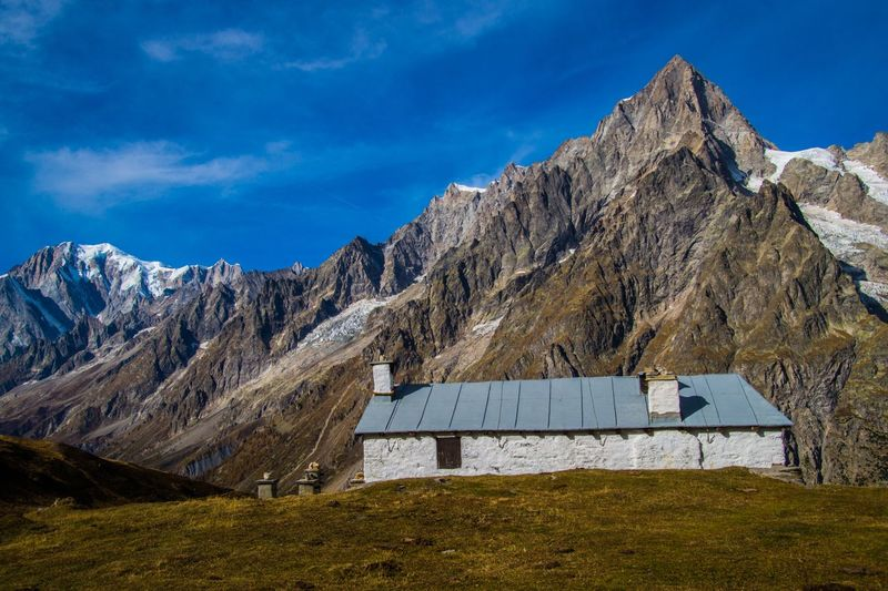 mallatra,val ferret,courmayeur,italy Mountain Mountain Range Sky Architecture Built Structure Scenics - Nature Environment Nature Landscape Cloud - Sky Mountain Peak Day No People Land Building Exterior Blue Travel Destinations Beauty In Nature Building Outdoors