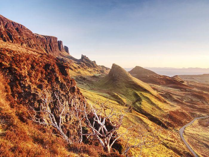 Quiraing mountains sunset with dramatic sky in scottish highlands isle of skye united kingdom