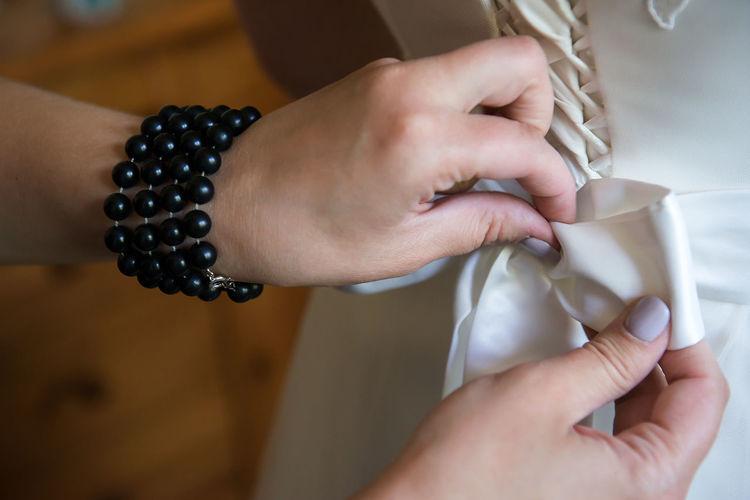 Dress Fashion Hands Ribbon Wedding Wedding Details White Dress Bracelet Bridal Close Up Concept Finger Hand Human Body Part Human Hand Lifestyles Style Wedding Detail Wedding Dress Wedding Inspiration Women