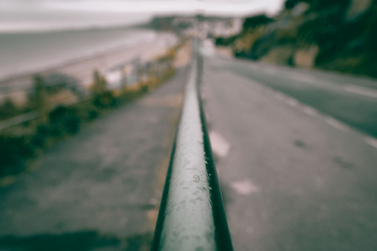 Close-Up Of Railing Against Road