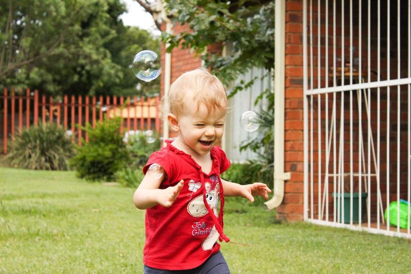 Laughing Laugh Smile Happy Kid Child Baby Girl Toddler  Outside Outdoors Garden Play Playing Soap Bubbles Running