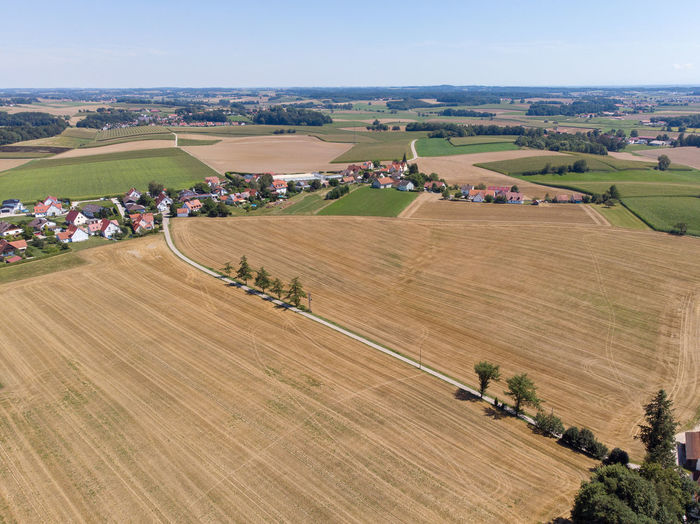 Dronephotography Aerial View Drone Point Of View Nature Land Day No People Outdoors Fields Agriculture Environment Village Road Landscape Rural Scene Field Farm Harvesting Rolling Landscape Tree Blue Sky House Bavaria