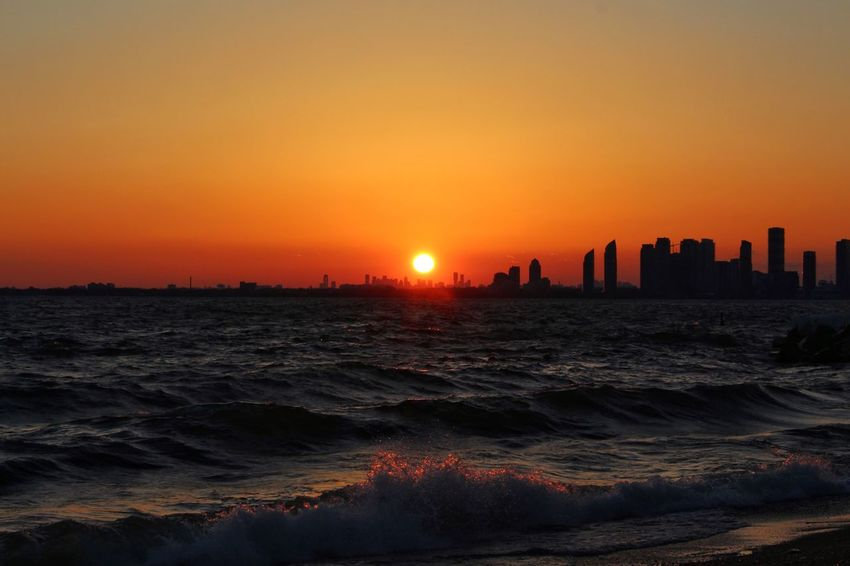 Wave after wave Lake Sunset Sky Architecture Orange Color Water Built Structure Beauty In Nature No People Beach Sun City