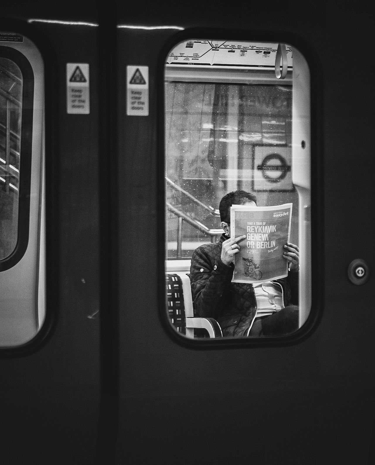 MAN SITTING ON TRAIN WINDOW