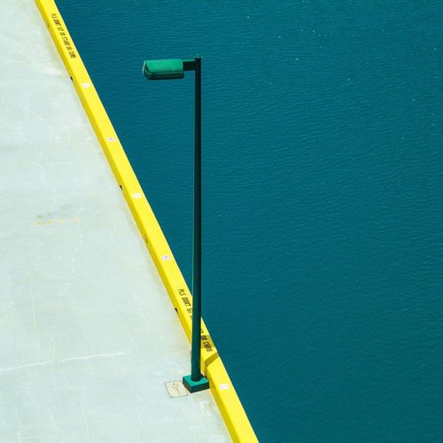 High Angle View Of Street Light By Sea On Pier