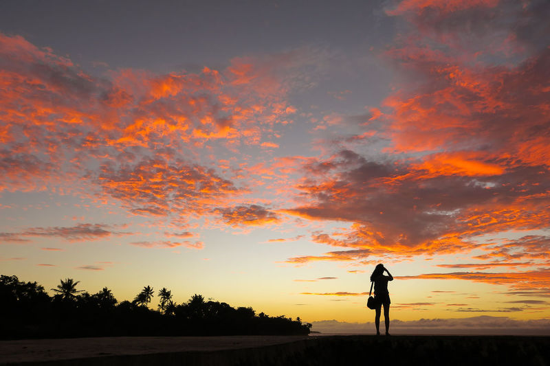 Photographer tourist girl silhouette on a pink sky sunset beach Beach Sunrise Beach Sunset Culture Digital Nomad Filipino Girl Independence It's More Fun In The Philippines Philipines Philippines Photographer Photography Pink Pink Clouds Silhouette Sky Solo Sunrise Sunset The Philippines Tourist Traveler Traveller Vacation Woman