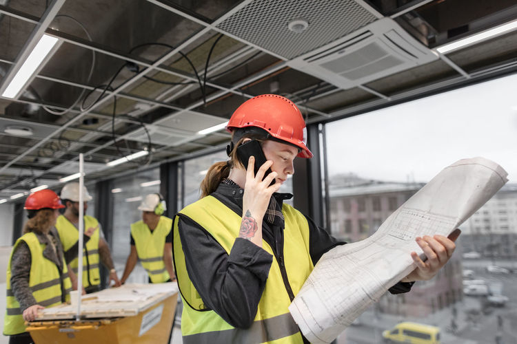 Man working on mobile phone
