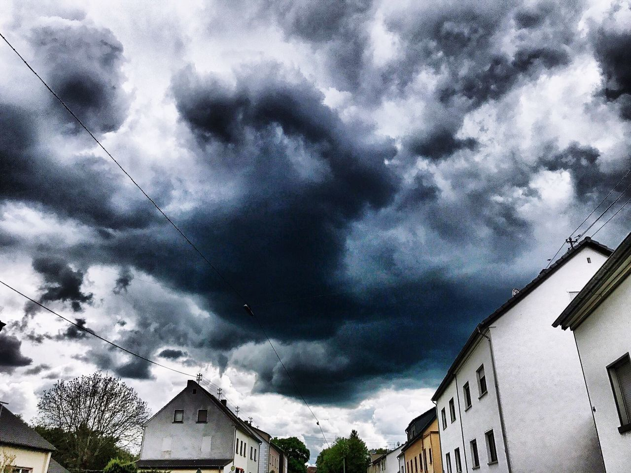 built structure, architecture, cloud - sky, building exterior, sky, house, no people, weather, storm cloud, low angle view, outdoors, day, residential building, nature