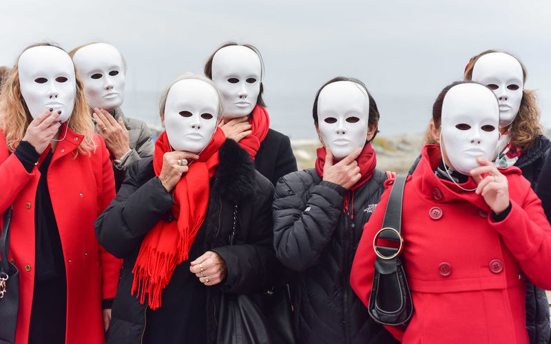 Women with a white mask protest against the violation of women EyeEmNewHere Protest Against The Violation Of Women Clothing Cold Temperature Costume Day Disguise Group Of People Human Representation In A Row Lifestyles Mask Mask - Disguise Outdoors People Real People Red Representation Scarf Side By Side Standing Warm Clothing White Mask Winter Women