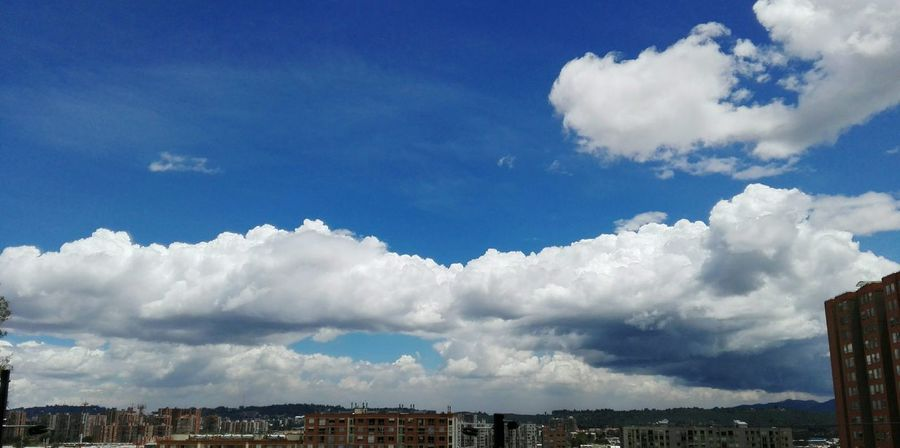 Cloud - Sky City Sky Blue Outdoors Day Mountain Vacations Roof No People Architecture Modern Nature Cityscape