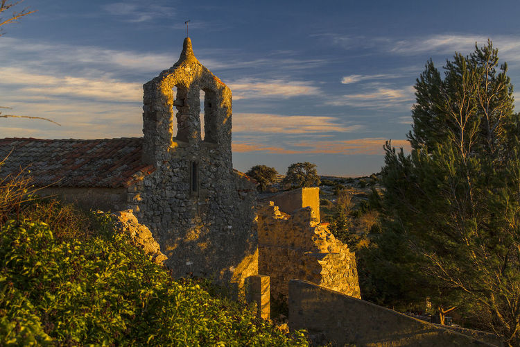 Perillos Opoul-Périllos Church Abandoned Village France Architecture History The Past Built Structure Sky Nature Plant Tower Building Exterior Ancient Building No People Old Cloud - Sky Travel Travel Destinations Old Ruin Religion Fort Tourism Outdoors Ancient Civilization Ruined Archaeology