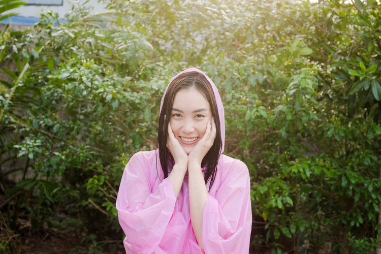 Adult Cheerful Child Children Only Day Girls Happiness Human Body Part Human Hand Looking At Camera Nature One Girl Only One Person Outdoors People Pink Color Plant Portrait Smiling Young Adult