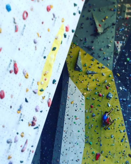 Low angle view of man bouldering on climbing wall
