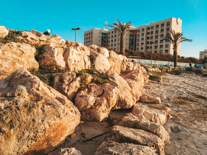 Beach Sand Sea Rock - Object Sky Architecture Building Exterior Built Structure Rock Formation Graffiti Rocky Mountains Eroded Street Art Geology Historic Natural Arch