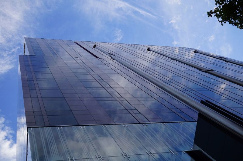 Cityscape Reflection Sky And Clouds Reflections Urban Geometry Sky Cloud - Sky Architecture Low Angle View Built Structure Building Exterior Day Building Blue Glass - Material Nature City