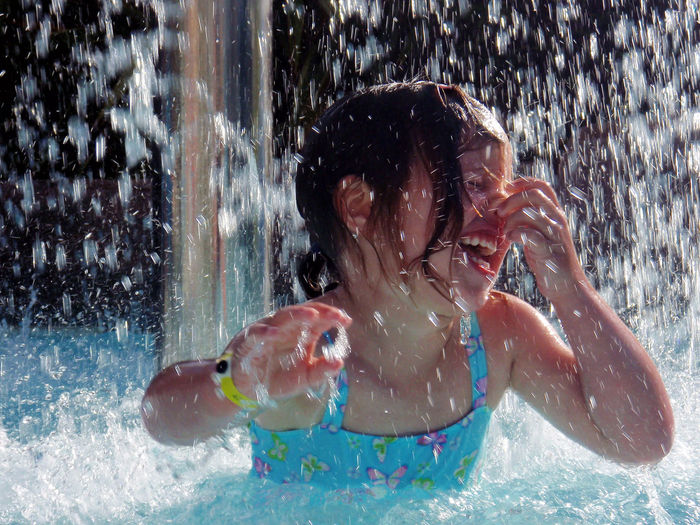 Close-up of happy girl in swimming pool