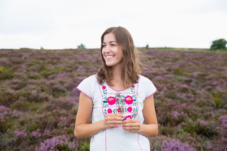woman standing in a field of heather Derbyshire English Countryside Beautiful Woman England Field Flower Happiness Heather Heather Flower Nature One Person Peaks District Plant Purple Smiling Waist Up Wildflowers Women Young Adult