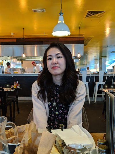 Portrait of woman sitting in restaurant